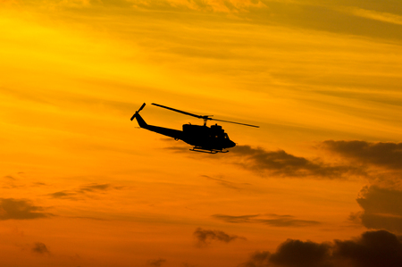 blackhawk helicopter: Silhouette of a Military Black Huey helicopter at sunset Stock Photo