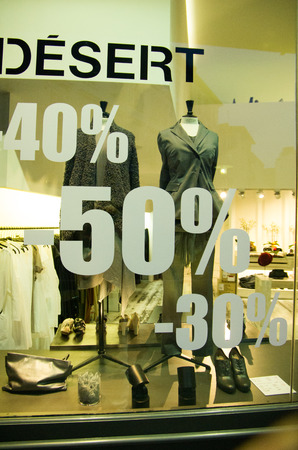 shop window: Sale sign in a French shop window Stock Photo