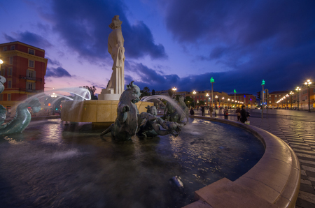 cote d'azur: Night time image of La Fontaine du Soleil (The Fountain of the Sun) with the Statue of Apollo in Nice, Cote dAzur, France