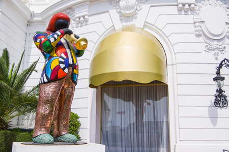 eec: NICE,FRANCE-APRIL,30: Statue by Niki de Saint Phalle, mosaic sculpture of Miles Davis IN front of Negresco Hotel on the 30th of april in Nice,france