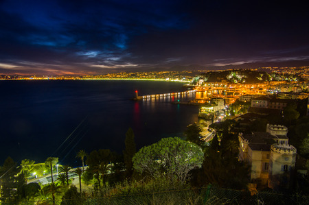 traditionally french: Nightview of the city of Nice and angelsbay from the petit corniche, Nice,France