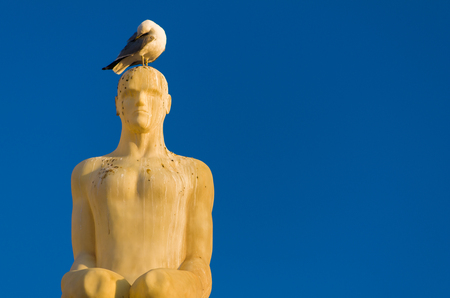 One of the seven statues from Conversation à Nice by Jaume Plensa on place Masséna - Nice, France Stock Photo