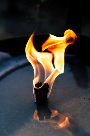 lampe: Close up of the flame burning from an Oil lamp in the beach Cannes,France Stock Photo