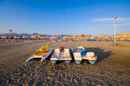 viareggio: View of a private beach with umbrella,chairs and a small boat in Viareggio,Italy,Europe
