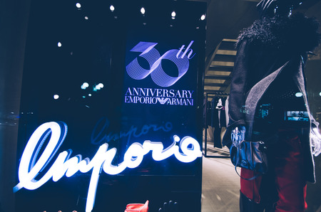 contender: MILANO,ITALY-NOV.09: emporio armani celebrates 30 years with a window shop decoration in Milan,Italy on the 09th november 2011. Giorgio Armani holding is one of the main contender in the fashion world.