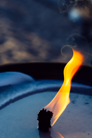 Close up of the flame burning from an Oil lamp in the beach Cannes,France Stock Photo