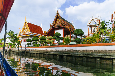 Thailand, Bangkok, view of the Chao Praya river and a Buddhist temple Stock Photo