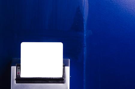 keycard: Hotel room keycard door lock. The keycard is white