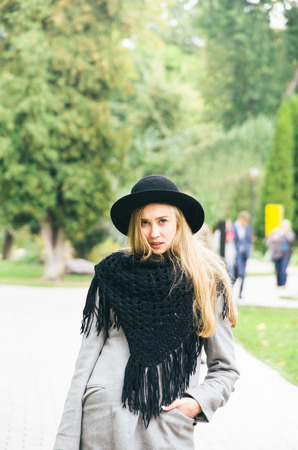 Portrait of a beautiful blonde girl with french style dressed in an autumn day
