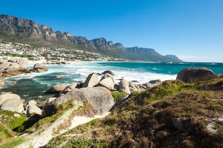 table mountain national park: The coastal line of camps bay with the twelve apostle mountains behind it. Camps Bay is one of the most exclusive resort of south africa. Stock Photo