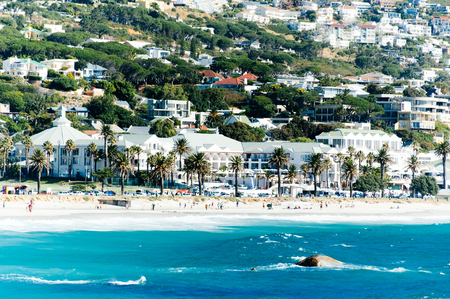 The coastal line of camps bay with the twelve apostle mountains behind it. Camps Bay is one of the most exclusive resort of south africa. Stock Photo