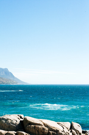 Here is the coastal line of camps bay with the twelve apostle mountains behind.