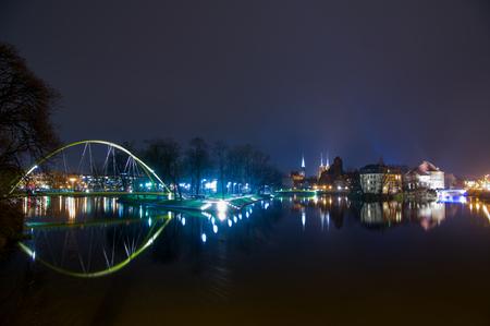 The Malt Footbridge K?adka S?odowa at night on the odra river, Wroclaw, Poland