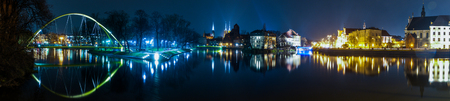 Wroclaw general cityscape by night with Odra river and Cathedral. High resolution panorama. From left to right the K?adka S?odowa Pedestrian Bridge, the trumski island and the ossolineum library
