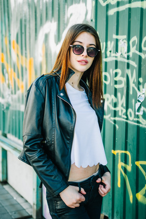 grundge: Young beautiful brunette walk in a city against a grundge background Stock Photo