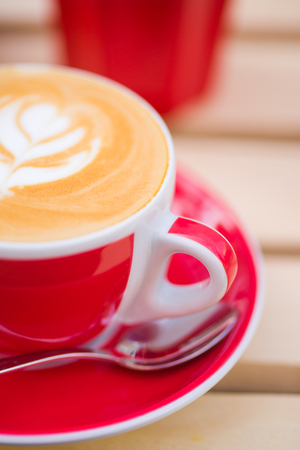 macchiato: Close-up of cup of Cappuccino coffee with some cool design on the foam Stock Photo