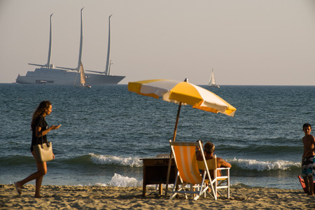 billions: LIDO DI CAMAIORE,ITALY-JUL.22:Yacht A, owned by Russian billionaire Andrey Melnichenko, is anchored off Lido di camaiores coast, on the 22th of july 2017 in the coastline of tuscany,Italy. The 143 meter long yacht is th elongest sail boat in the world.