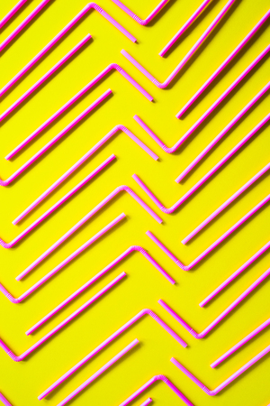 Abstrat background formed with multiple straws over a yellow flashy background, studio shot,  Texture theme. Stock Photo