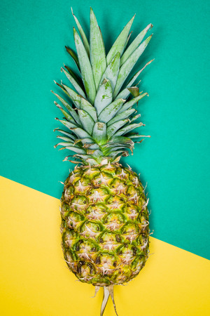 flashy: Ananas over a brazilian flags background Stock Photo