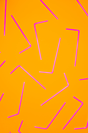 Abstrat background formed with multiple straws over an orange flashy background, studio shot,  Texture theme.