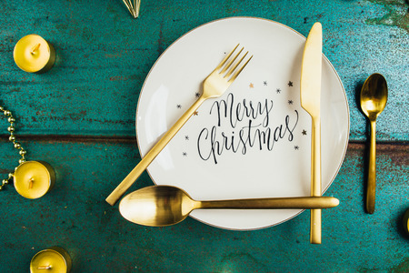 Christmas luxury holiday concept, with a plate with text impressed