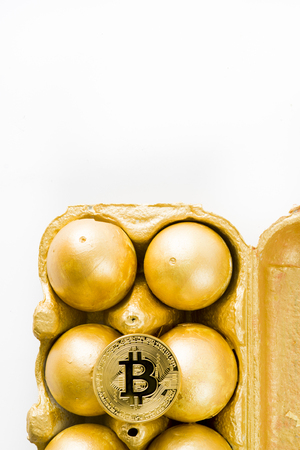One old aesopus story  tells about the chick who makes the golden egg, in this case she makes bitcoin, conceptual composition for bitcoin and new economy, with golden eggs cracked with bitcoin outside 写真素材