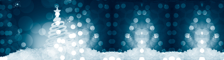 Christmas tree decoration on snow, against a beautiful holiday inspired background, poster format, bluish tonality,copy space left Foto de archivo