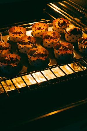 Cooked muffin are taken out from the oven