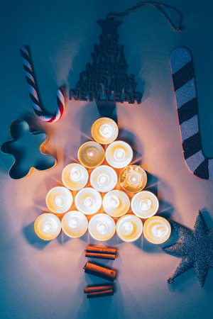 Abstract christmas tree concept made with golden candles lighte up , graystar and cinnamoon stick with other christmas decoration Imagens