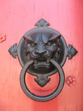 Ornament knocker on a church entrance door photo