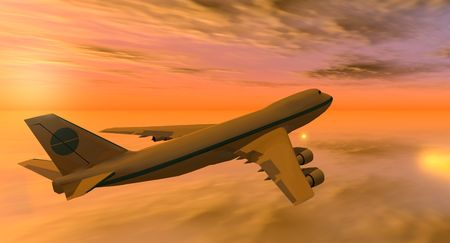 aeronautics: 747 flying in an yellow and orange sky at sunset Stock Photo