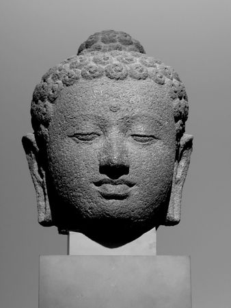 buddha head: a black and white image of a cambodian buddhas head