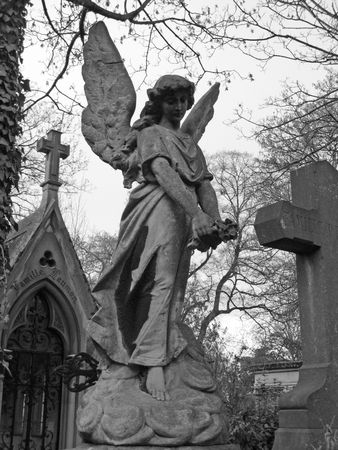 angel headstone: Angel sculpture in Pere Lachaise parisian cemetery