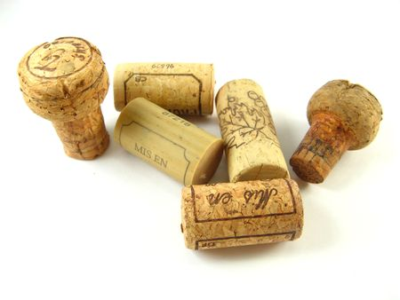 some corks of wine bottles over a white background Stock Photo