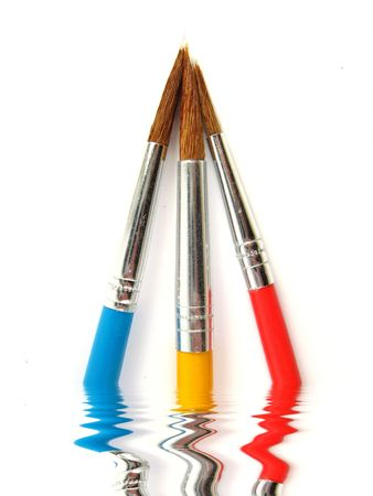 some colored paintbrushes over a white background Stock Photo - 2466396