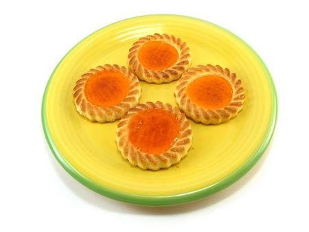 una imagen de algunas tartas en una placa de color amarillo  Foto de archivo - 2776424