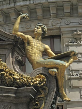 Golden statue in front of the opera Garnier in Paris