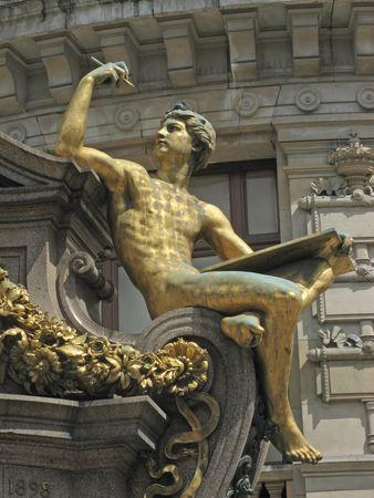 garnier: Golden statue in front of the opera Garnier in Paris