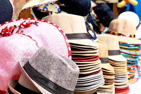 Beautiful fancy hats for sale in a picnic spot, selective focus