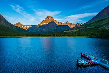 Morning sun begins to brighten Mount Wilbur at Swiftcurrent Lake - Glacier National Park - Montana