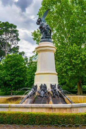 The Fallen Angel statue at El Retiro Park is framed suitably by a dark cloudy sky - Madrid, Spain Stockfoto