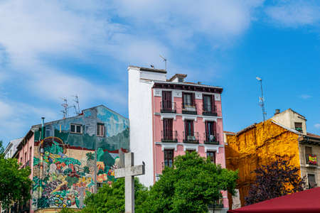 Colorful fruit mural one one house and a pink facade provide a colorful urban display in Madrid, Spain