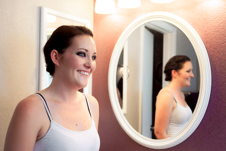 bright eyed: A young bride with make up done anticipates putting her wedding dress on and walking down the aisle. Stock Photo