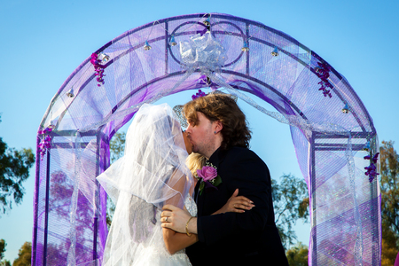 alter: A couple shares their first kiss at the alter during their wedding ceremony.