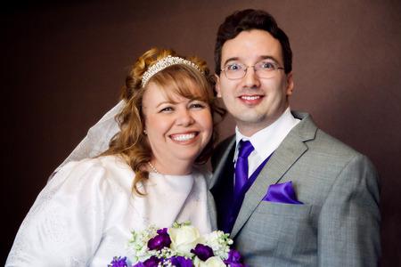 a newly married couple: A newly married couple poses for a portrait lit by window light.  It has a painterly feel.
