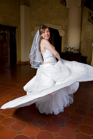 twirls: A bride twirls in her wedding dress. Stock Photo