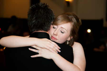 A Bride Hugs Her Father At The End Of The Father Daughter Dance