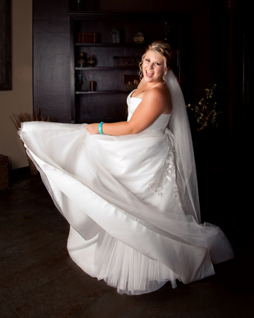 twirls: A stunning, plus size bride twirls in her wedding dress before the ceremony.  She is full of life and joy. Stock Photo