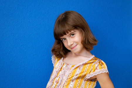 A very confident and sassy looking young girl poses for the camera while showing off her haircut.  Copy space. Stock Photo