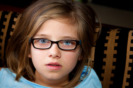 disbelief: A stunned, young, blond girl looks at the camera in disbelief.  Her eyes are blue and wide open and her dry lips are slightly parted.